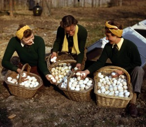 World War Two. England. March, 1944. Land army girls with a large basket of freshly laid eggs as they breed chicks at redlands poultry farm at South Holmwood in Surrey.